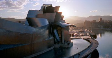 The sun sets behind the magnificent Bilbao Guggenheim.